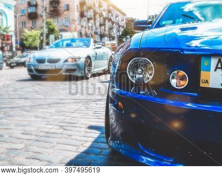 Kiev, Ukraine - May 14, 2011: Ford Mustang Saleen S281 Supercharged And Bmw M6 In The City
