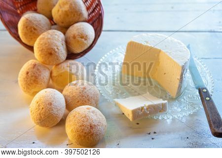 Cheese Bread From Brazil, Paes De Queijo And Minas Cheese On An Old White Table With Blurred Nature