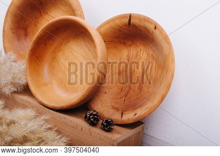 A Set Of Plates Made Of Recycled Material. Natural Wood Utensils. Zero Waste. Reusable Utensils. Ree