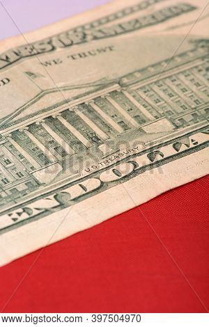 Ten Dollar Bill In Front Of The American Flag