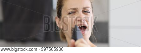 Woman Holds Comb In Her Hands And Sings In Front Of Mirror. Morning Energy Boost For The Whole Day C