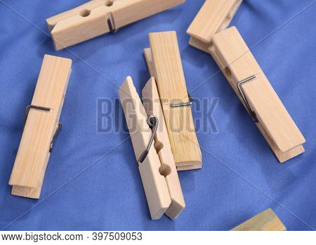 Wooden Clothes Pin. Closeup Pin Set On Blue Background
