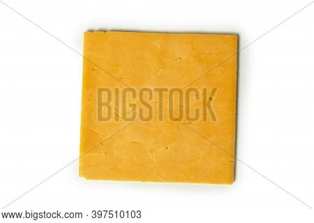 Slice Of Cheese Cheddar Isolated On A White Background.