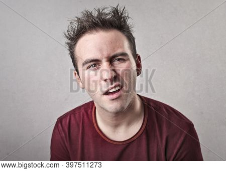 young man looks in the room trying to understand something