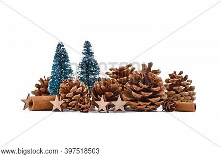 Christmas Arrangement With Seasonal Pine Cones, Small Christmas Trees, Wooden Ornaments And Cinnamon