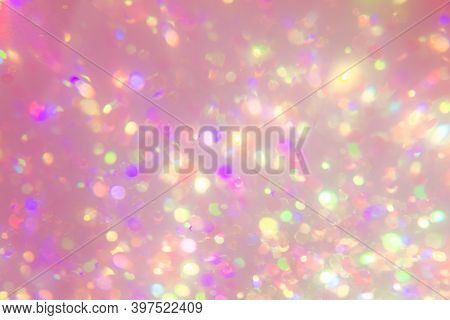Pastel Colorful Bokeh Light On Pink Backdrop. Blurry Holographic Background. Kaleidoscope Ray. Holid