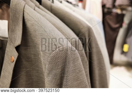 Men Casual Jackets Hang On Coathangers At Showroom