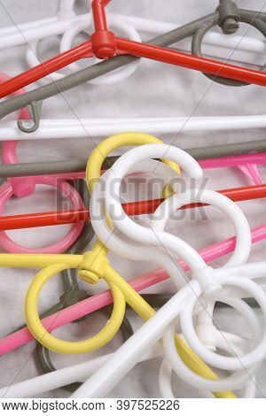 Many Clothes Hanger. Trempel On A White Background. Store Concept For Sale, Design. Empty Hanger Set