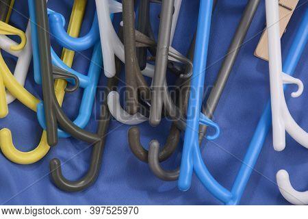 Many Clothes Hanger. Trempel On A Blue Background. Store Concept For Sale, Design. Empty Hanger Set.