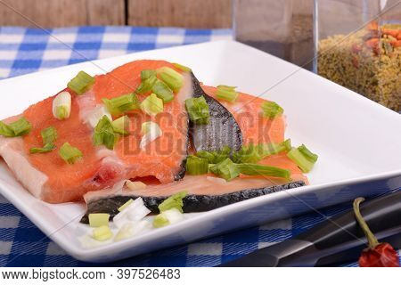 Food Concept: Red Salmon Fish, Red Hot Chilli Pepper Spice With Greens. Healthy Food Cooking.
