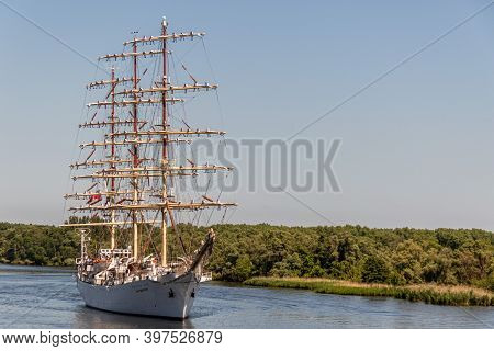 Szczecin, Poland -  May 11, 2015: Tall Sail Ship Dar Mlodziezy Approaches The City, Sailors Stand On