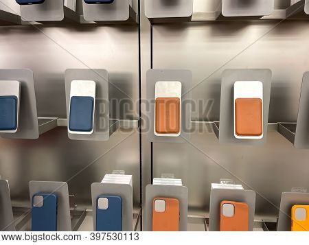 Orlando, Fl Usa-november 20, 2020: An Apple Store Display Of Colorful Iphone Magsafe Wallets And Cas