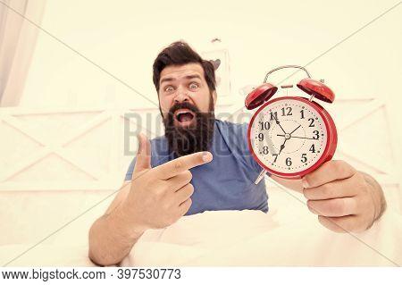 Unhappy Man Pointing At The Alarm Clock. Hate Noise Of Alarm Clock. Man Awake With Retro Alarm Clock