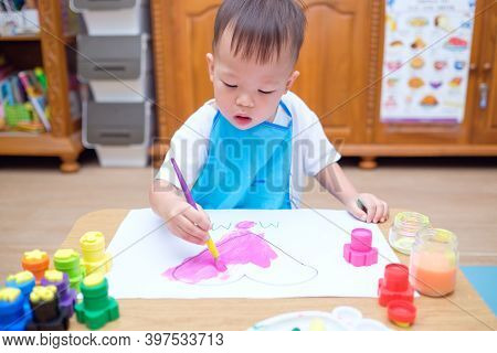 Cute Little Asian 2 Years Old Toddler Baby Boy Child Painting With Paint Brush & Watercolors, Kid Dr