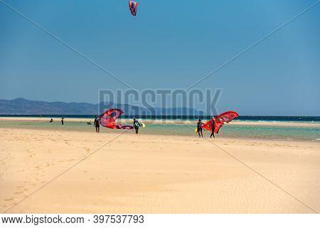 Sotavento, Fuerteventura, Spain: 2020 October 8: Man Practicing Kitesurfing In Playa De Sotavento, F
