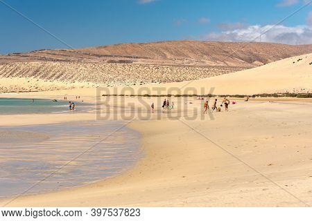 Sotavento, Fuerteventura, Spain: 2020 October 8: Young Blonde Woman Walks Through The Dunes At Playa