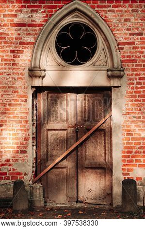 Abandoned Church Christian Parish. The Boarded Up Door To The Old Church.