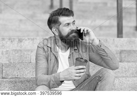 Holding Conversation Over Cup Of Coffee. Bearded Man Have Phone Conversation. Answering Conversation