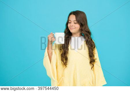 Feeling Comfy. Adorable Child On Turquoise Background. Comfy Outfit For Weekend Rest At Home. Comfy