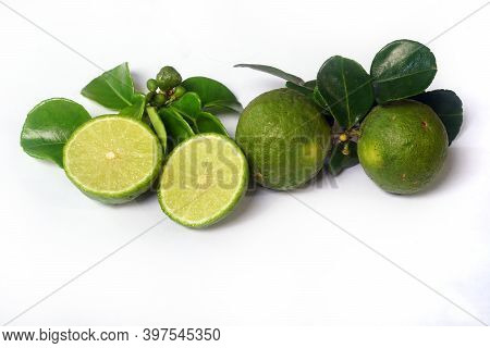 Kaffir Lime Or Citrus Hystrix. Some Are Whole, Some Have Been Sliced. Focus Selected, White Backgrou