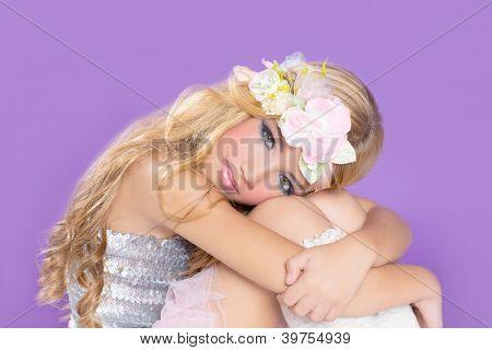 blond princess fashion girl fashiondoll with spring flowers on purple