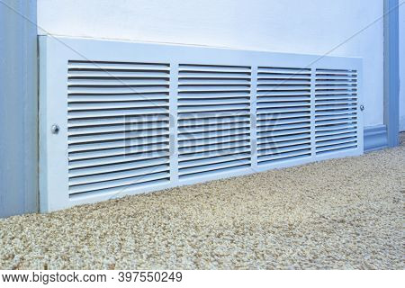 Cold Air Return Vent Inside Residencial Home, Air Vent On A White Wall With Carpet.