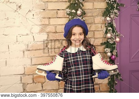 Have An Ice Day. Happy Ice Skater. Little Child Hold Ice Skates. Small Girl Enjoy Ice Skating. Figur