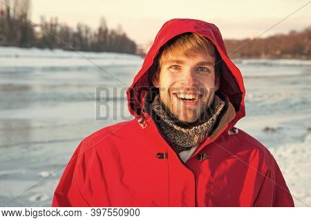 Ice Fishing Is Winter Tradition. Man Warm Jacket Clear Solid Ice Background. Exploration Of Polar Re