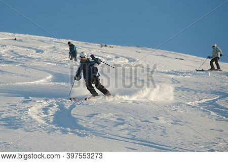 LES ORRES, FRANCE - CIRCA 2016: Young skier coming down fast in fresh powder snow off-piste.