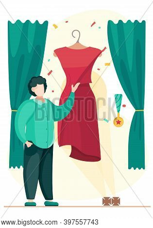 The Guy Stands And Points To A Red Dress Hanging On A Mannequin. The Designer Demonstrates The Finis