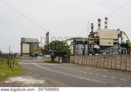 Roadway Running Alongside Industrial Production Mill You