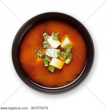 Miso traditional Japanese soup with tofu and spring onion. Isolated on white background. Top view flat lay