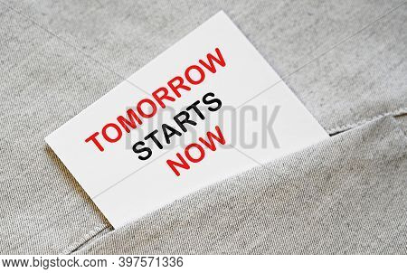 Tomorrow Starts Now. Motivational Phrase On A Note .