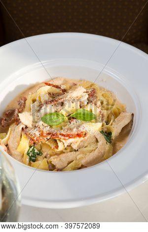 Italian Chicken Pasta Served In White Plate