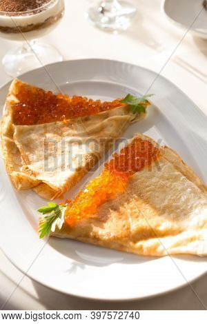 Pancakes Served With Red Caviar For Breakfast