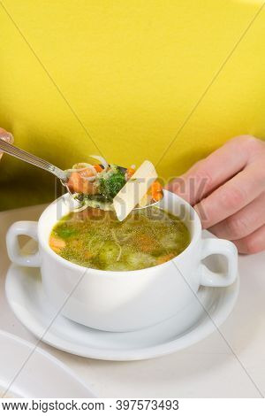Woman Eating Minestrone Soup In The Cafe