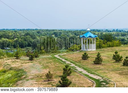 The Path To A Rotunda On The Grass With Firs In Azov City