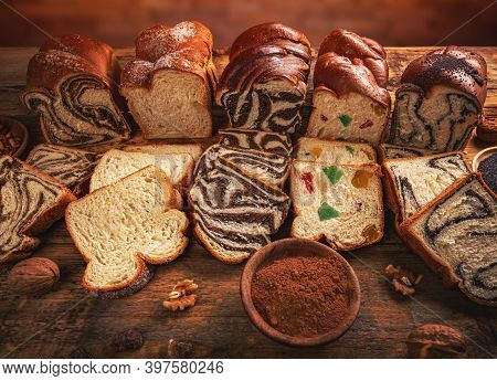 Composition Of Sweet Braided Bread With Different Stuff On Wooden Background