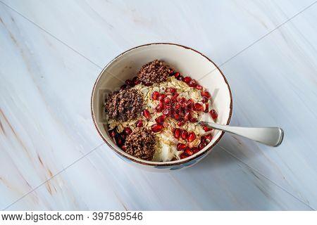 Amaranth Chocolate And Granola With Yogurt, Honey, Pomegranate Seeds. Yoghurt.