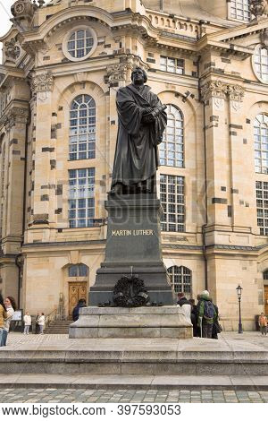 Dresden, Germany - September 17, 2010: The Martin Luther Monument Against The Frauenkirche In Dresde