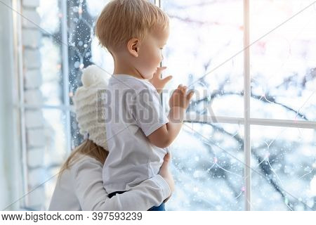 Two Cute Adorable Little Blond Cauasian Children Siblings Stay Near Window And Looking Outside Waiti