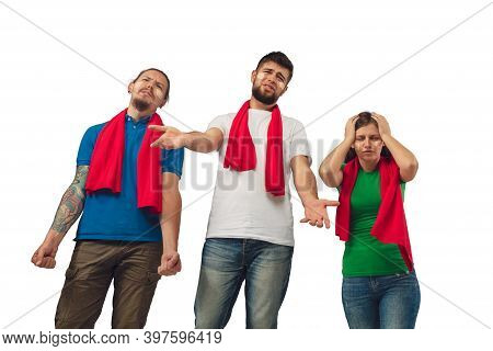 Shocked. Female And Male Soccer Fans Cheering For Favourite Sport Team With Bright Emotions Isolated