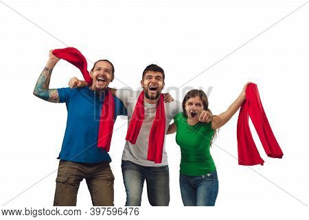Excellent Goal. Three Soccer Fans Woman And Men Cheering For Favourite Sport Team With Bright Emotio