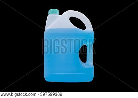 Winter Window Blue Cleaner Isolated On A Black Background With Clipping Path. Plastic Canister With