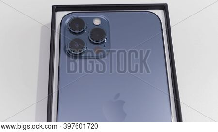Kiev, Ukraine-11.20.2020: Close Up Of A Back View Of New Smartphone In A Box. Action. Newest Pacific
