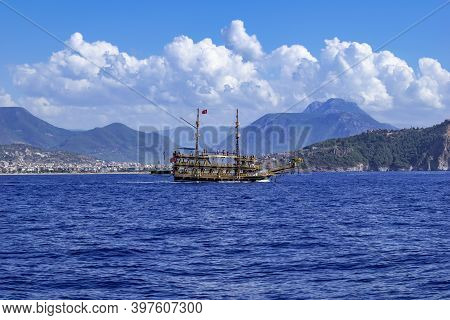 Large Wooden Vintage Galleon On The Background Of Alanya (turkey) Among The Mountains - View From Th