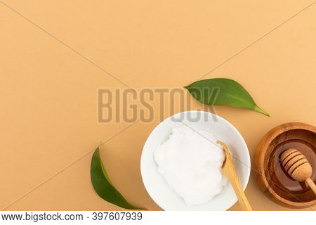 Bowls with yoghurt and dressing on yellow background. fresh whole foods healthy living copy space concept.