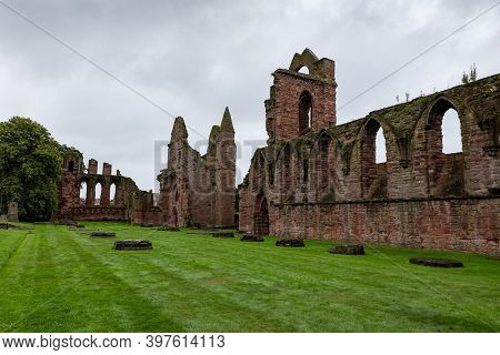 Arbroath, Scotland - August 11, 2019: Red Brick Ruins Of Medieval Arbroath Abbey And Courtyard In Sc