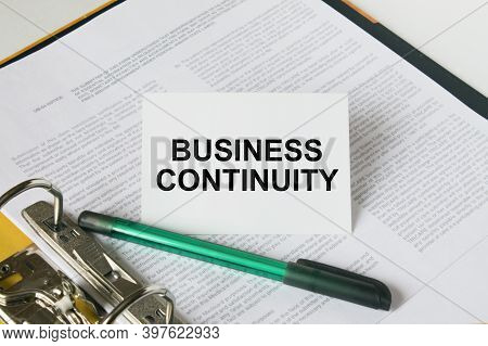 Text Business Continuity On A White Card That Is In A Folder With Documents And A Green Pen