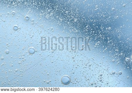 The Texture Of A Transparent Cosmetic Gel With Bubbles On A Blue Background. Serum, Moisturizing Lot